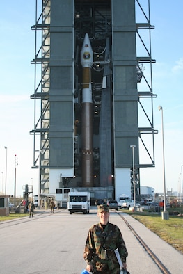 Capt. Davina Fallaw stands in front of an Atlas V booster at Cape Canaveral. Captain Fallaw's flawless support of the Atlas V program has garnered her the Gen. Charles Horner award.