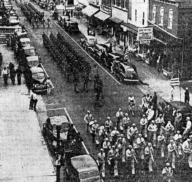 Captain Ralph Bond and his boys marching through the center of the state capital on Saturday, September 26 to stimulate the War Bond sales.
