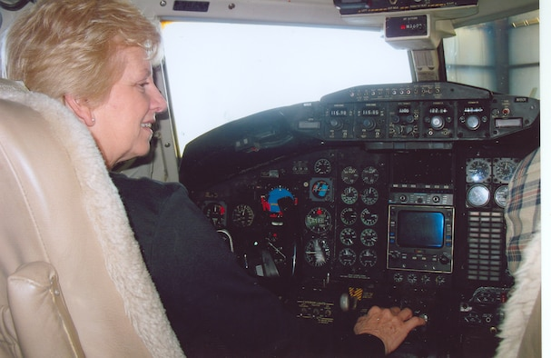 Betty Spray, an Aerospace Testing Alliance contract administrator, performs pre-flight checks in the cockpit of a North American T-39 Sabreliner jet, one of the planes she and her husband own. (Photo provided)