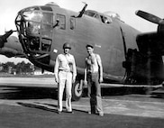 Lt. Col. Bent and M/Sgt Suttles pose in front of B-24.
