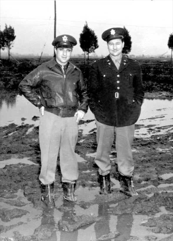 """Capt """"Bob"""" Anderson and Squadron Medico A Lt. Knopke (Wing Dentist) - The mud of Dover, Jan 1943."""