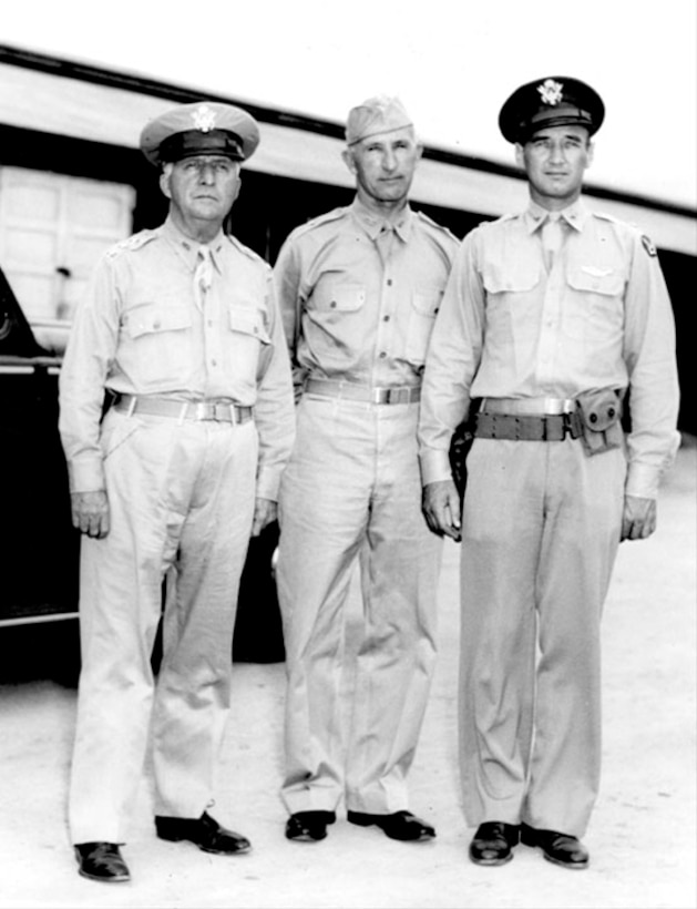 Lt. General Hugh A. Drum, inspects air field at Dover. Municipal Airport at Dover was visited last week by Lieut. Gen. Hugh Drum, commanding general of the Eastern Defense Command and First Army, and Brig. Gen. R. Haynes. Pictured left to right are General Drum, General Haynes and Major Alfred E. Bent, commanding officer at Dover.
