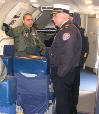 An aircrew member on the E-3 Sentry Airborne Warning and Control System, or AWACS, aircraft from the 552nd Air Control Wing based at Tinker Air Force Base, Okla., briefs Rome Fire Department Chief Roger Sabia about the AWACS mission.