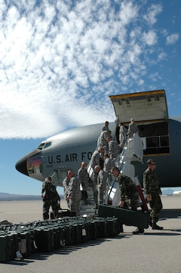 Arizona Air National Guard Security Forces troops load their deployment gear on a KC-135 tanker at Tucson International Airport. The 19 Airmen assigned to the 162nd Fighter Wing hitched a ride with the 171st Air Refueling Wing on their way to Baghdad International Airport, Iraq, for a voluntary six-month tour of duty, Feb. 24. The Guardsmen, who provide full-time security for the 162nd Fighter Wing at Tucson International Airport, will use their training and expertise to secure Iraq's largest airport. The Airmen are scheduled to return to Tucson in early September. (Photo by Capt. Gabe Johnson, 162nd Fighter Wing)