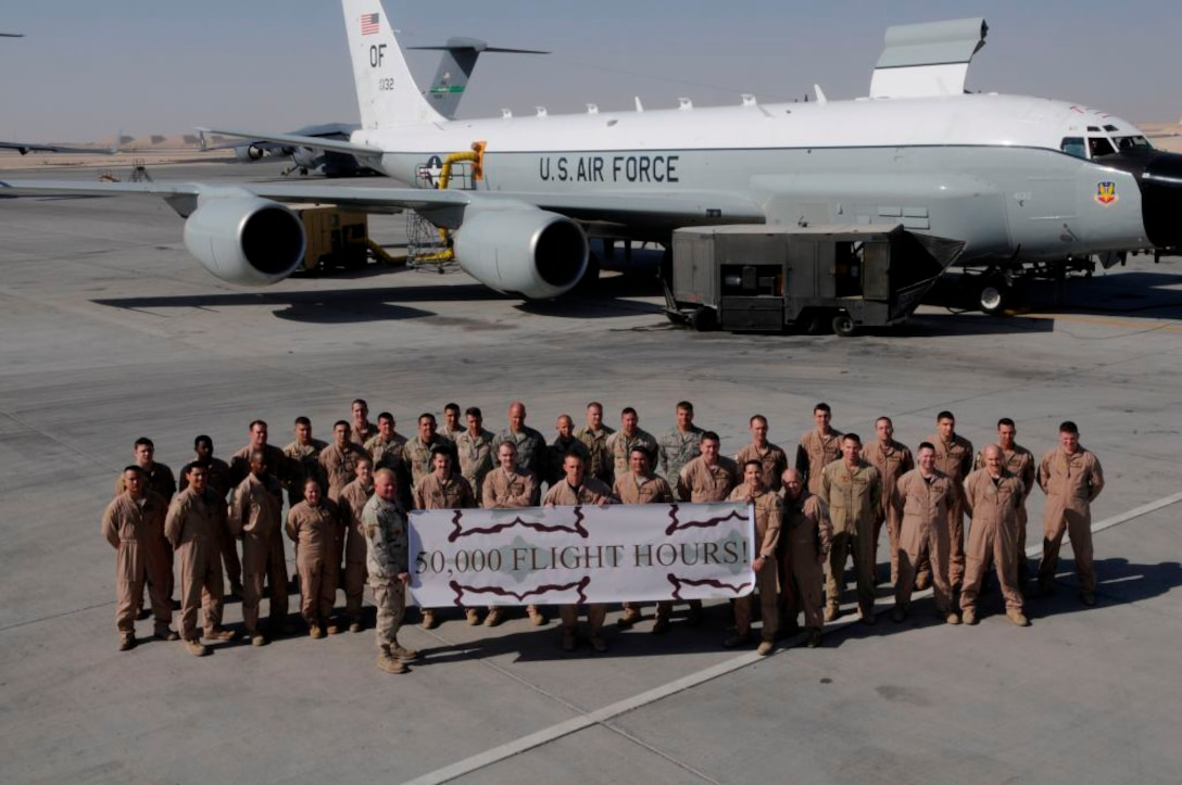 Deployed members of the 55th Wing pose for a celebratory photo following their Rivet Joint aircraft surpassing the 50,000 flying-hour mark.