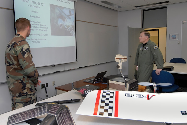 (Right) Maj. Gen. Stephen T. Sargeant, Air Force Operational Test and Evaluation Center Commander, listens to a U.S. Air Force Academy cadet's Captone briefing during a March 17, 2008 visit to the Academy.