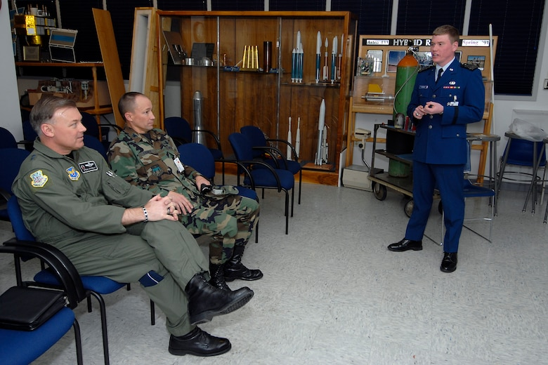 (Left) Maj. Gen. Stephen T. Sargeant, Air Force Operational Test and Evaluation Center Commander, listens to a U.S. Air Force Academy cadet during a Cadet Capstone team briefing.
