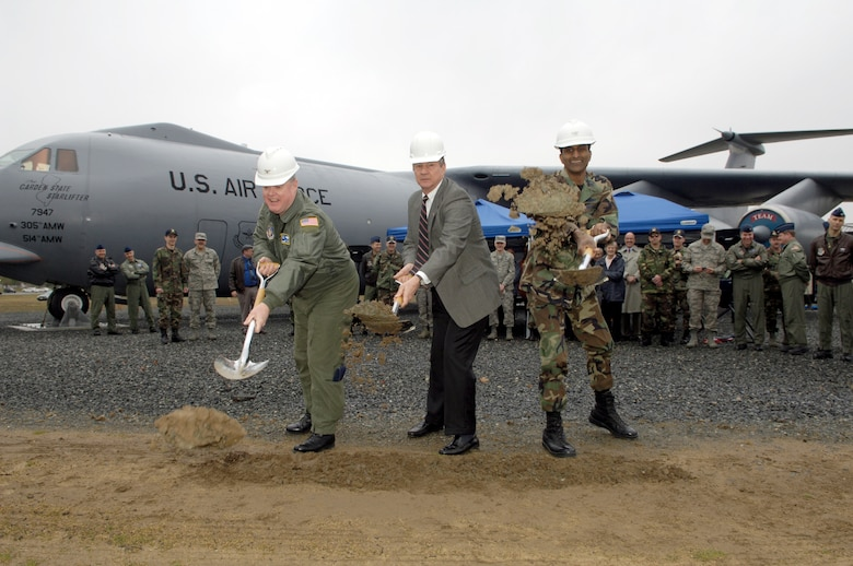 "Col. James Kerr, 514th Air Mobility Wing commander, Ted Strempack, Thomas B. McGuire Foundation president, and Col. Balan Ayyar, 305th AMW and installation commander, shovel the first dirt during a ground breaking ceremony for McGuire AFB's C-141 Starlifter Memorial Park.  The C-141 was the backbone of Air Mobility Command and its predecessor, Military Airlift Command, and it traveled the globe for nearly 41 years delivering cargo, troops and hope during peacetime and war.  This memorial, which displays the flagship of McGuire Air Force Base's original fleet, will honor the lives lost and the mission excellence demonstrated by McGuire Airmen who flew, maintained and supported this historic aircraft.  The aircraft on display at McGuire, was named ""The Garden State Airlifter"" in recognition of the state's contribution to the Air Force mission.  In August 1967, it was the first C-141 to be delivered to McGuire. (U.S. Air Force photo by Kenn Mann)"