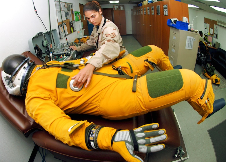 Staff Sgt. Nikolina Kreager, a life support specialist with the 99th Expeditionary Reconnaissance Squadron at an air base in Southwest Asia, ensures a U-2 Dragon Lady pilot is set for the day's mission by checking the flight suit to make sure it can pressurize properly at high altitudes.  (U.S. Air Force photo/Senior Airman Levi Riendeau)