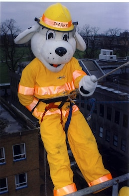 Staff Sgt. Sean Katz, 100th Civil Engineer Squadron fire Department, dressed as Sparky the Fire Dog before rappelling down an 80-foot tower at Cambridgeshire Fire Station March 16. He joined 19 British firefighters, from fire stations in the local area, to help raise money for a children's cancer charity. (Courtesy photo)