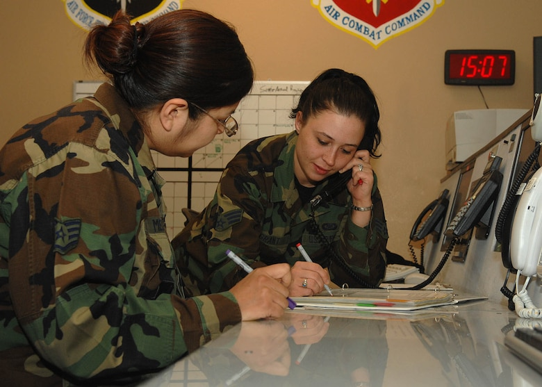 Staff Sgt. Trudy Medina (left) and Senior Airman Shayla Grant (right), 355th Fighter Wing Command Post, call  the chain of command after getting a simulated phone call of an individual getting a DUI off base and going through their checklist to make sure everyone gets notified.  The Airmen that all work in the Command Post gets a lot of training to make sure in a real world emergency they are prepared for what can or would happen.  The command post is responsible for communicating with the base to make sure all the units get the information needed throughout the base and the chain of command.  (Photo By USAF: Senior Airman Jacqueline Hawkins)