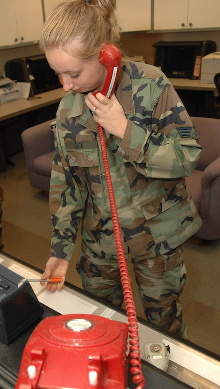 Senior Airman Melissa Rice, 355th Fighter Wing Command Post, makes the call to alert the necessary units to make sure they are able to respond if necessary. The command post is responsible for communicating with the base to make sure all units get the information needed throughout the base and the chain of command. (Photo By USAF: Senior Airman Jacqueline Hawkins)