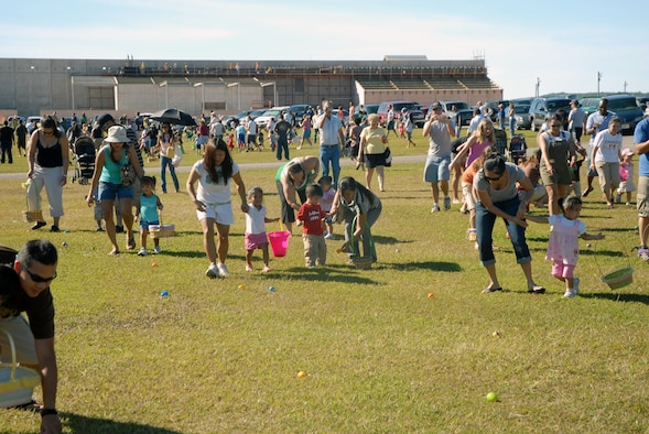 Team Andersen members make a mad dash for Easter eggs during the base Easter egg hunt March 22 at Arc Light Park. (Courtesy photo)