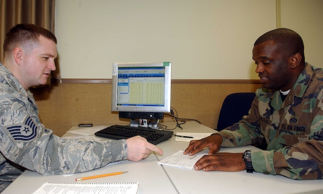 Tech. Sgt. Michael McBride, a tax center volunteer from the 51st Munitions Squadron, discusses itemized tax deductions with Staff Sgt. Rockson Jeanlouis, 51st Civil Engineer Squadron. The tax center offers a variety of free services including electronic filing and preparation of federal income taxes. (U.S. Air Force photo/Staff Sgt. Candy Knight)