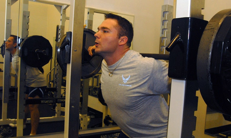 VANDENBERG AIR FORCE BASE, Calif., --  2nd Lt. Michael Tuchscherer, a student at the 392nd Training Squadron warms up before starting his power lifting work out at the base gym on Mar. 3. Tuchscherer took first place in the Quest American Invitational Arnold Classic Power Lifting Competition this past weekend in his weight of 275 lbs. (U.S. Air Force photo / SrA Christopher Hubenthal)