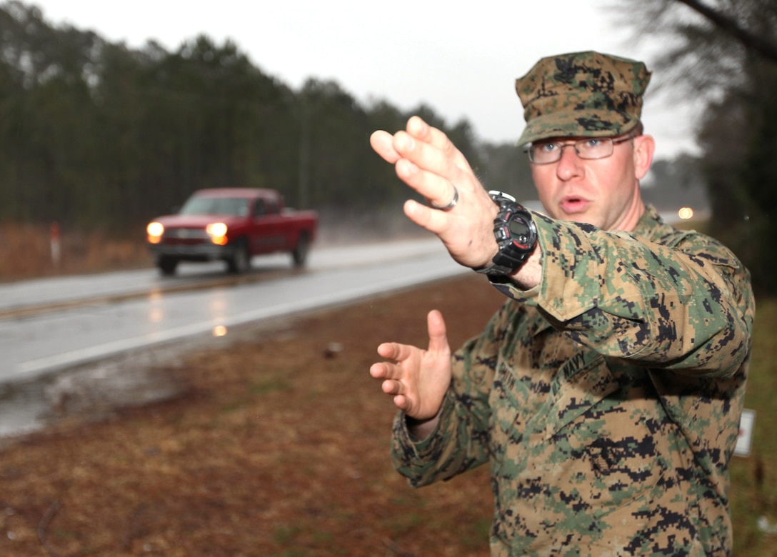 Petty Officer 2nd Class Jason B. Smith, a corpsman with II Marine Expeditionary Force Special Operations Training Group, describes a three-car accident on U.S. Highway 210 where a pickup truck rear ended a small sedan, Jan. 27, 2010.  Smith and a fellow SOTG corpsman, Petty Officer 1st Class Jesus F. Santiago, pulled a woman from one of the vehicles involved in the accident as flames engulfed her vehicle. (U.S. Marine Corps photo by Staff Sgt. Jayson Price)