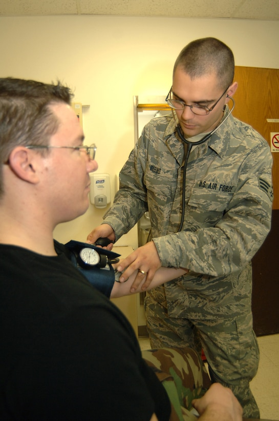 Senior Airman Ryan Rubino, 55th Medical Operations Support Squadron, checks a patient's blood pressure at the Ehrling Bergquist Clinic's Urgent Care Center. Beginning, April 1, the UCC will become an appointment-only acute care clinic. Appointments can be made by calling 232-CARE. For emergency care, patients should call 911 or report immediately to their nearest emergency room. (U.S. Air Force Photo/Tech. Sgt. Rhonda Moraski)
