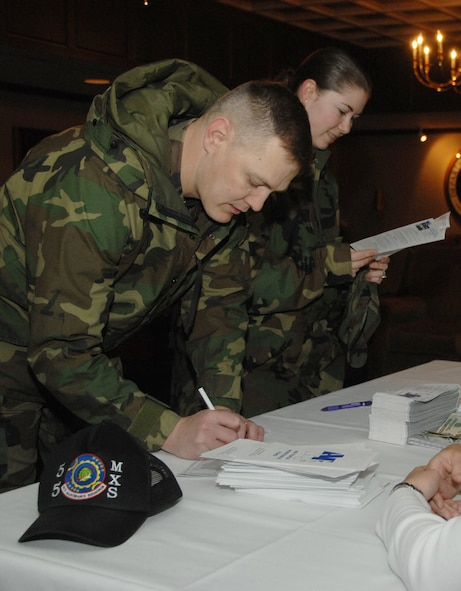 Master Sgt. Jesse Hilderbrand, 55th Maintenance Squadron, and Staff Sgt. Kellie Herman, 55th Maintenance Group, fill out AFAF donation forms. The event raised $1,985 towards Offutt's goal of $104,242. Offutt's AFAF campaign runs through May 2. To make a donation to the AFAF, contact unit key workers or Master Sgt. Jason Heiden at 294-5270. (U.S. Air Force Photo/Dan Rohan)