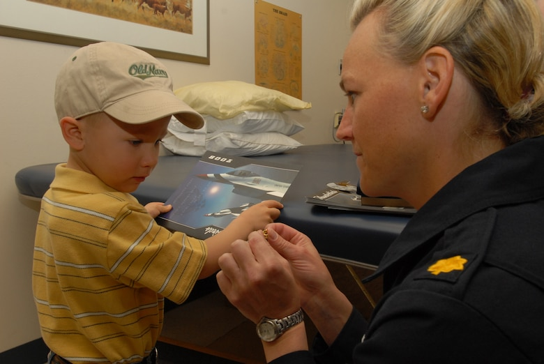 Braden Peiser, son of Erica Peiser, gets pinned by Maj. (Dr.) Charla Quayle during a Thunderbirds visit to San Angelo Community Medical Center in San Angelo, Texas. Dr. Qualye, flight surgeon for the entire Thunderbirds team, and several enlisted personnel spent time with patients, employees and family members as part of the teams visit to San Angelo for Air Fiesta '08.  (U.S. Air Force Photo by Master Sgt Randy Mallard)