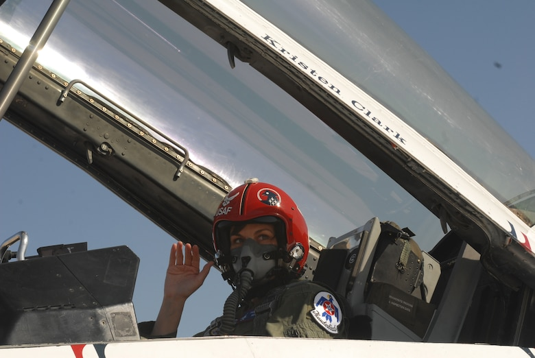 Kristin Clark, an anchor with KLST News in San Angelo, waves prior to her media flight March 13. Mrs. Clark was instructed in proper entry, exit and safety procedures for the F-16 Fighting Falcon prior to her flight, which helped the news anchor better tell the Air Fiesta '08 story. (U.S. Air Force photo by Master Sgt. Randy Mallard)