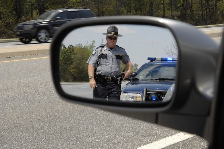 MOODY AIR FORCE BASE, Ga. – Deputy Raymond Devogt, Lowndes County Sheriff's deputy, pulls over a speeding driver on Bemiss Road here March 27.  Deputy Devogt ensures that Bemiss Road motorists follow the rules of the road. (U.S. Air Force photo by Senior Airman Angelita Lawrence)
