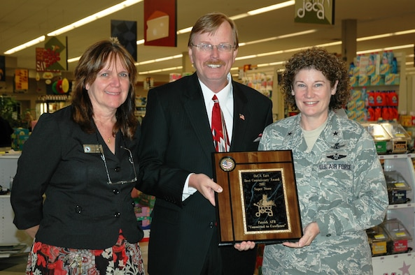 Patrick Commissary Administrator Susan Gutierrez, Store Director Ron Rogers and 45th Space Wing Commander Brig. Gen. Susan Helms show the first place award plaque given to the Patrick Commissary as best in the Eastern Region out of 98 stores. (U.S. Air Force photo by Chris Calkins)