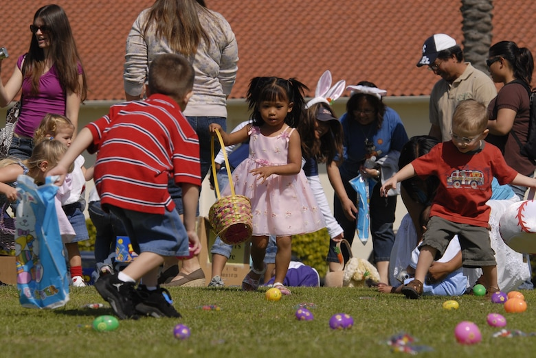 Children scramble for Easter eggs during the annual egg hunt on Fort MacArthur, March 22. A petting zoo, magic show, Easter egg hunt and visit from the Easter Bunny were all part of the festivities. (Photo by Joe Juarez)