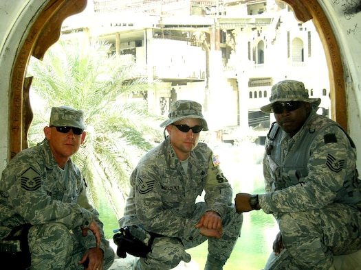 (From left to right) Master Sgt. Jeff Thornsberry, Tech. Sgt. James Mulcahey and Tech. Sgt. Dion Hawkins pause to take a photo near remnants of the former Iraqi regime in Baghdad, Iraq. The three Guardsmen deployed with 16 other 162nd Security Forces Squadron members to Baghdad International Airport for a voluntary six-month tour of duty which began Feb. 24. The Guardsmen, who provide full-time security for the 162nd, now use their training and expertise to secure Iraq's largest airport. They are scheduled to return to Tucson in September. (Air National guard Photo)