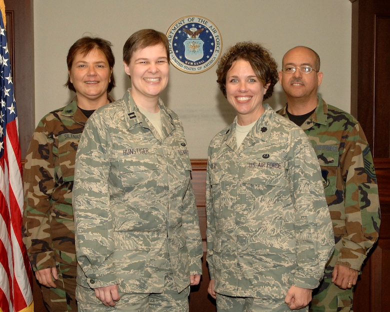 Left to right, Lt. Col. Rima V. Silenas, Capt. Candace L. Hunstiger, Lt. Col. Dawn M. K. Zoldi and Senior Master Sgt. Patrick Vilmenay pose for a photo March 26 at the 11th Wing Legal Office. Six members of the 11th Wing garnered Air Force District of Washington Judge Advocate General Awards, which were announced March 21. Colonel Silenas is currently on Reserve duty at the Air Force Legal Operation Agency.(U.S. Air Force photo by Thomas Dennis)