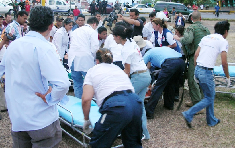 SOTO CANO AIR BASE, Honduras--The scene at Hospital Escuela in the Honduran capital Tegucigalpa was seems chaotic as the hospital staff, Honduran emergency medical technicians and Joint Task Force-Bravo MEDEVAC crew unloaded people injured in a bus crash site near Choluteca, Honduras Easter Sunday. During the MEDEVAC, the crew performed airway intubation and CPR on one patient who quit breathing during the flight. (U.S. Air Force photo)