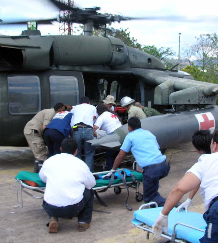SOTO CANO AIR BASE, Honduras--Honduran emergency medical technicians unload injured passangers from a Joint Task Force-Bravo UH-60 Blackhawk MEDEVAC Easter Sunday.  The Blackhawk, dispatched from JTF-Bravo to the bus crash site near Cholutecca, Honduras and transported the injured to Hospital Escuela in the Honduran capital Tegucigalpa.