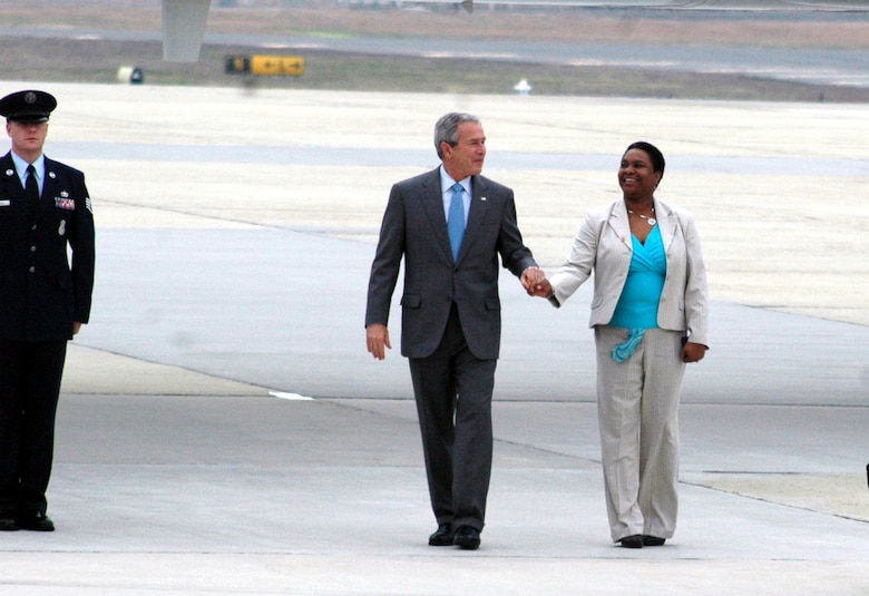 President of the United States George Bush greets with Mrs. Andrell Reid, a military spouse, after arriving at McGuire Air Force Base, N.J., March 28, 2008.  Mrs. Reid received a presidential pin in recognition for outstanding volunteerism.  She is the spouse of Army Master Sgt. Raymond Reid of Fort Dix, N.J.  (U.S. Air Force Photo/Tech. Sgt. Scott T. Sturkol)