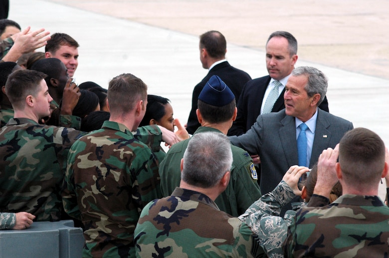 President of the United States George Bush shakes hands and greets Airmen at McGuire Air Force Base, N.J., March 28.  The President came through the base en route to a visit to Freehold, N.J.  (U.S. Air Force Photo/Tech. Sgt. Scott T. Sturkol)