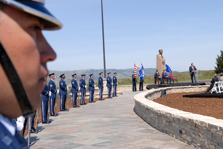 VANDENBERG AIR FORCE BASE, Calif. --  Vandenberg's Base Honor Guard stand at parade rest along the walkway for the Ronald Reagan Memorial dedication while Arizona congressman Rep. Trent Franks speaks on March 27 here. The Ronald Reagan Missile Defense Site is dedicated to former President Ronald Reagan as a show of gratitude on the 25th Anniversary of his address to the nation on missile defense.(U.S. Air Force photo/Airman 1st Class Andrew Satran)