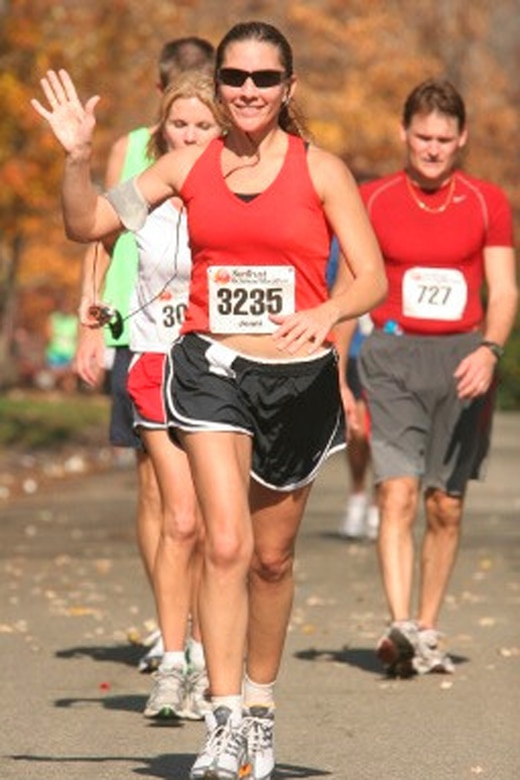"""Senior Master Sgt. Jennifer Burg enjoys a """"relaxing"""" moment at the Nov. 11, 2006 Richmond (Va.) Marathon, where she broke the 4-hour barrier and placed 34th of 200 in her 35-39 age group. (Photo courtesy of Senior Master Sgt. Jennifer Burg.)"""