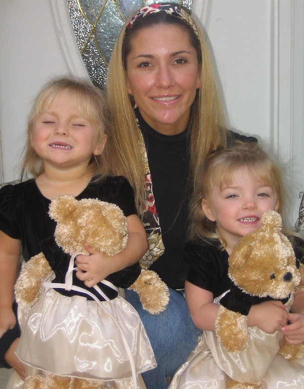 Senior Master Sgt. Jennifer Burg and her 3-year-old twin daughters Maddy, left, and Kaylee, born premature at 31 weeks in January 2005, relax at their Manassas, Va., home. Working closely with the March of Dimes in connection with the pursuit of her first Ironman at the Ford Ironman Louisville (Ky.) Aug. 31, Sergeant Burg has embarked on her own fundraising campaign to help battle birth defects, premature birth and infant mortality. (Photo courtesy of Senior Master Sgt. Jennifer Burg.)