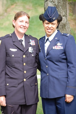 WASHINGTON, D.C. -- Tech. Sgt. Susan Mayer, 459th Military Equal Opportunity, poses at the Metropolitan Police Department graduation ceremony with Col. Stayce Harris, 459th Air Refueling Wing commander, April 25, 2008. Sergeant Mayer completed eight months of training April 11, as did Senior Master Sgt. Todd Cory (not shown), 459th Security Forces Squadron. Sergeant Mayer and Sergeant Corey are each 43. (Courtesy photo)
