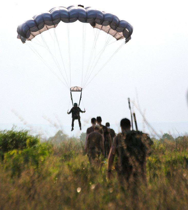 "Drop zone controllers head out to recover a jumper from the 320th Special Tactics Squadron during Exercise Teak Torch at Udon Thani, Thailand. Jumpers from both the 353rd Special Operations Group and the Royal Thai air force completed daily ""friendship jumps"" as part of the joint combined exercise training. (U.S. Air Force photo/Master Sgt. Marilyn Holliday)"