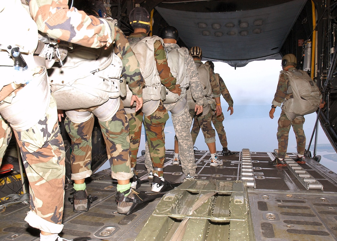 Special forces from the Royal Thai air force prepare to jump from an MC-130P Combat Shadow during Exercise Teak Torch at Udon Thani, Thailand.  The Thai troops and 353rd Special Operations Group Airmen exercised together as part of Pacific Command's joint combined exchange training. (U.S. Air Force photo/Master Sgt. Marilyn Holliday)