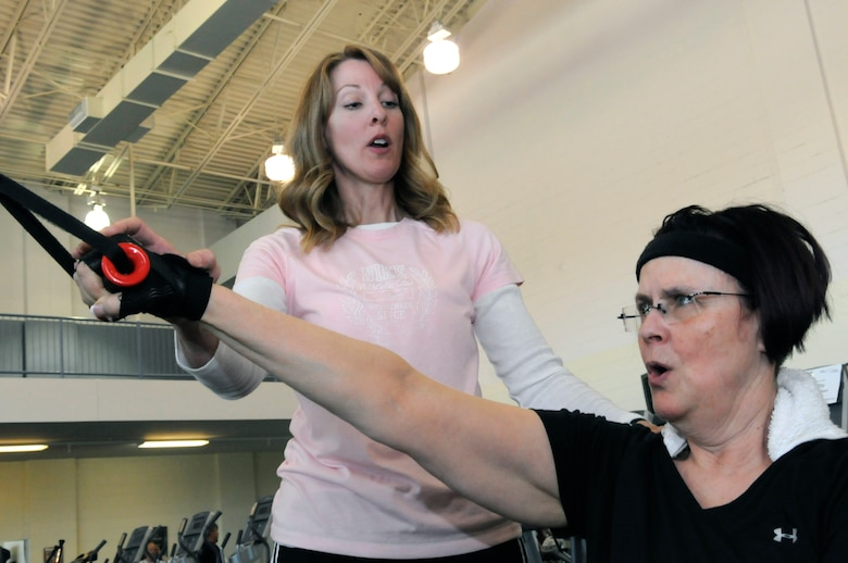 Kim Wilson, a contracted certified personal fitness trainer, works with Shirley Abbott Clark at Robins Fitness Center April 30. U. S. Air Force photo by Sue Sapp