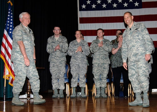 Three members of the 931st Air Refueling Group Intelligence Directorate join in applause during an awards gathering at McConnell Air Force Base in April.  The gathering was organized during a three-day visit to McConnell by Gen. Arthur Lichte(far left), Air Mobility Command commander, Scott Air Force Base, Ill.  The 931st troops were invited to the gathering after being named AMC's Outstanding Air Reserve Component Intelligence Unit of the Year. Attending were (from left to right) Staff Sgt. Joseph Johnson, Tech. Sgt. Crystal Maxton, and the directorate's commander, Lt. Col William Eaton.  Also out front is Col. James Vechery (far right), 22nd Air Refueling Wing Commander.