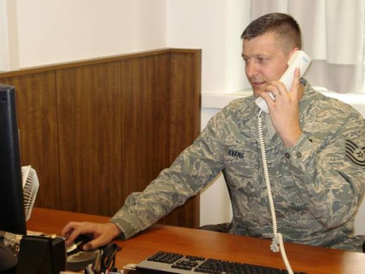 Tech. Sgt. Robert Evans interfaces with senior leadership on a tasking at the Joint NATO Command Branch office. (U.S Air Force Photo by Tech. Sgt. Regina Brewer)
