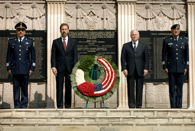 u s department of > photos > photo essays > essay view secretary robert m gates stands mexican officials after laying a wreath at the