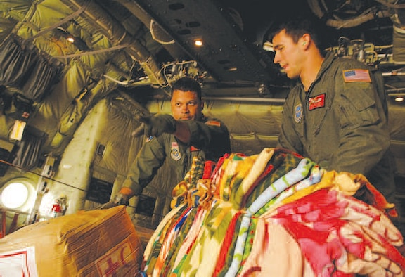 Tech. Sgt. Wilbert Morales and Senior Airman Brandon Krantz, both loadmasters