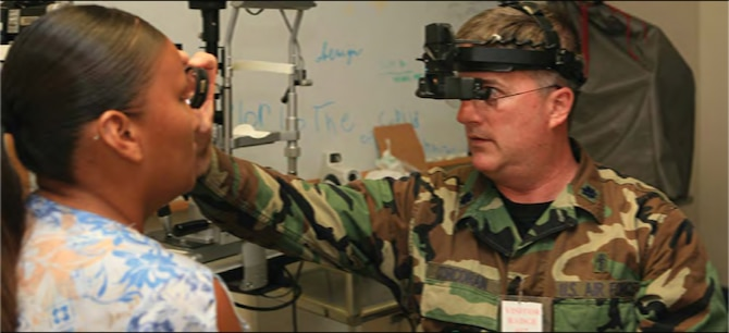 Air Force Lt. Col. Robert Corcoran, an optometrist with the 175th Medical Group, evaluates a patient at the Rosebud Comprehensive Health Care Facility in Rosebud, S.D.