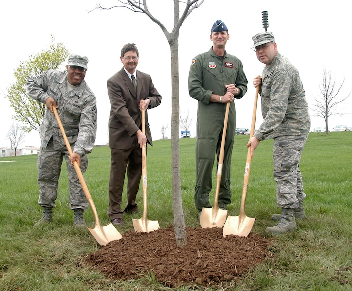 (From left to right) 55th Wing Command Chief Master Sgt. Kenneth Funderburg, Deputy Base Civil Engineer Mark Jacobsen, 55th Wing Commander Brig. Gen. James Jones and 55th Mission Support Group Commander Col. Michael Stinson participate in the annual Arbor Day Tree Planting April 25th here. Offutt has been named Tree City USA for the last 20 years by the Arbor Day Foundation. (U.S. Air Force Photo By/Jeff Gates)