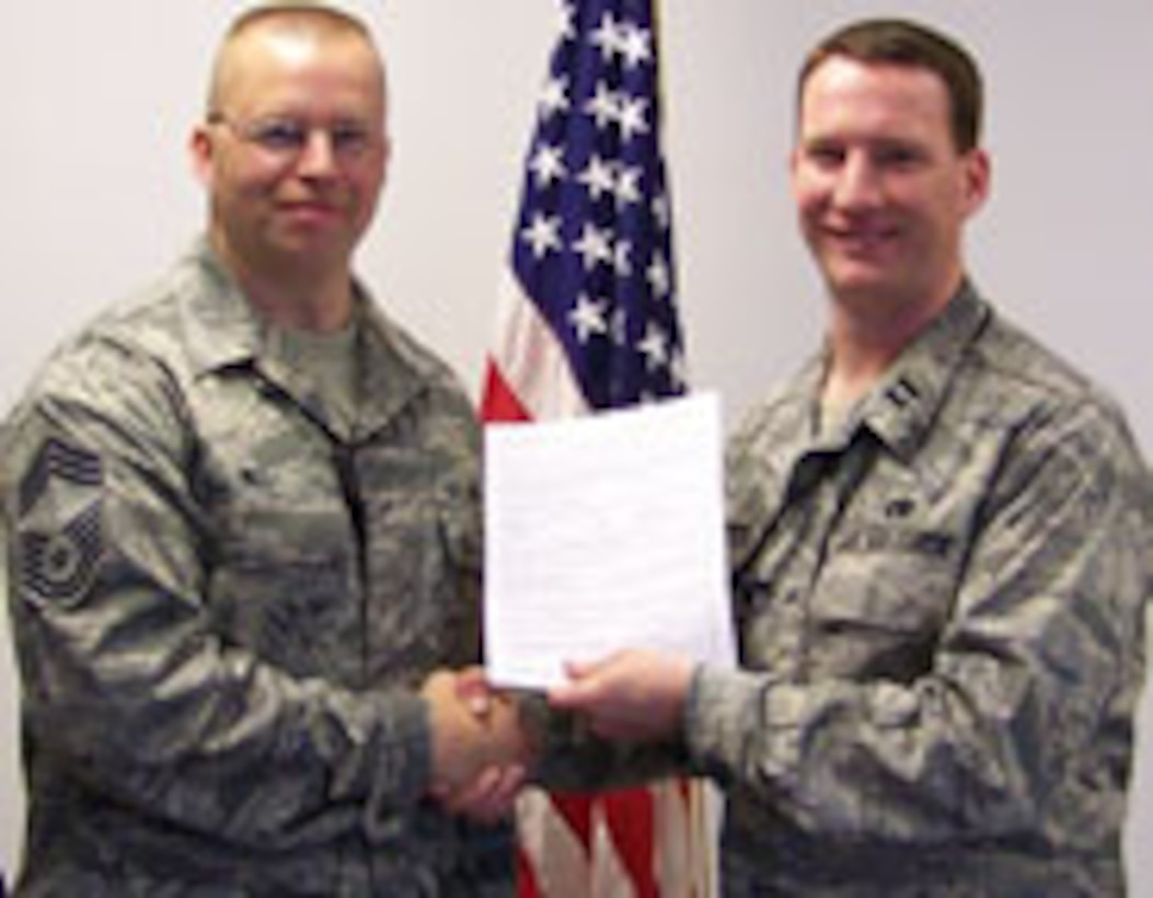AMXS Flight Chief CMSgt Mike Will re-enlisted with Capt Nick Lotito AMXS AMU OIC