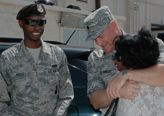 PATRICK AIR FORCE BASE, Fla. - Air Force Reserve mother Ms. Sharon Price receives a hug from 920th Mission Support Squadron commander Lt. Col. Dennis Seymour while her son, Staff Sgt. Jordan Kelly, prepares to deploy. The 920th Rescue Wing deployed 16 unit members May 2. The Airmen will be performing duties as U.S. Force Protection Escorts. It is the second deployment for Sergeant Kelly, who serves with the Security Forces squadron and recently returned home from a six-month tour of duty in Iraq. To serve our nation, Reservists make sacrifices to go above and beyond the commitments of civilian life -- balancing the demands of family, civilian employment, and military service. (U.S. Air Force Photo/Staff Sgt. Heather Kelly)