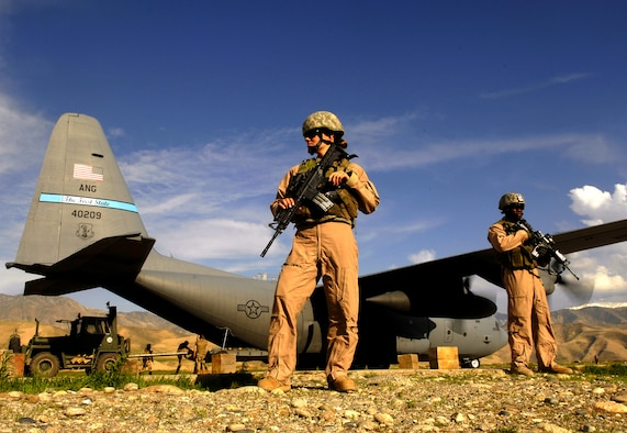 Airman 1st Class Kelliea Guthrie (left) and Senior Airman Greg Ellis provide security April 23, 2008 for a Delaware Air National Guard C-130 Hercules aircraft during a cargo mission at Feyzabab Airfield in Afghanistan. Both Airmen are part of the fly-away security forces team assigned to the 455th Expeditionary Security Forces. (U.S. Air Force photo by Master Sgt. Andy Dunaway)
