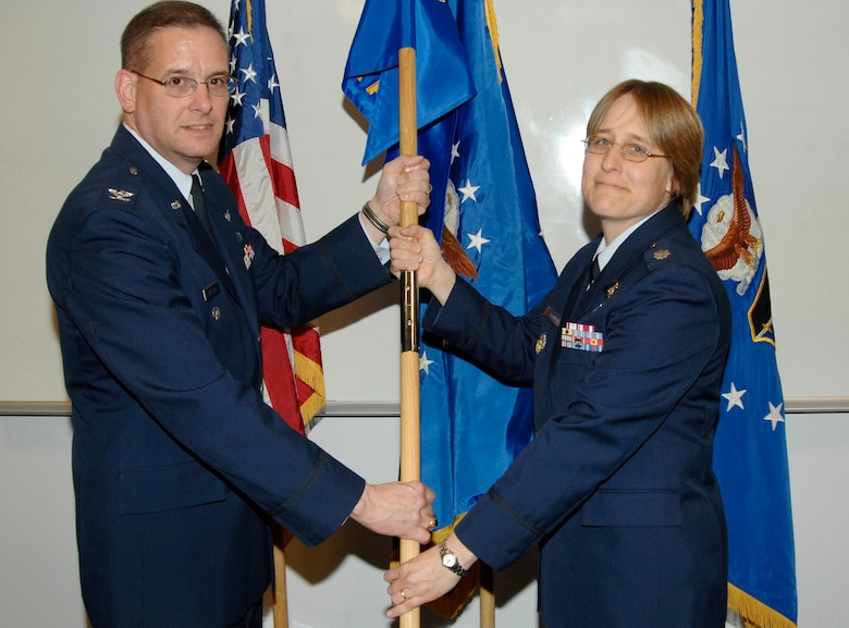 Lt. Col. Janet Grondin assumed command of the new GPS Advanced Control Squadron at the ceremony officiated by Vice Wing Commander Col. Don Wussler.  (Photo by Lou Hernandez)